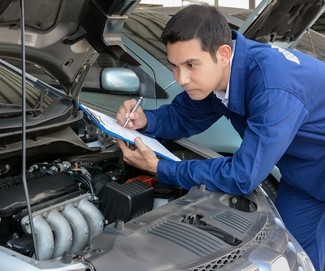 36848176 - auto mechanic (or technician) checking car engine at the garage